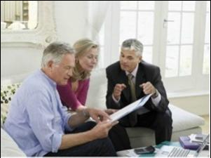financial advisor consulting senior couple at home