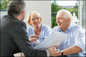 financial advisor consulting senior couple